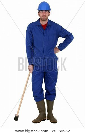 A tired- looking laborer