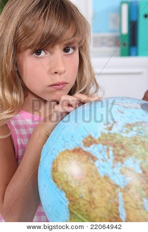 Girl looking at a large globe