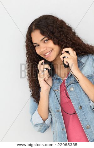 Portrait of smiling teenager listening to music