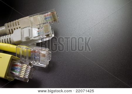 Macro Several Rj45 Network Connector On Black Background