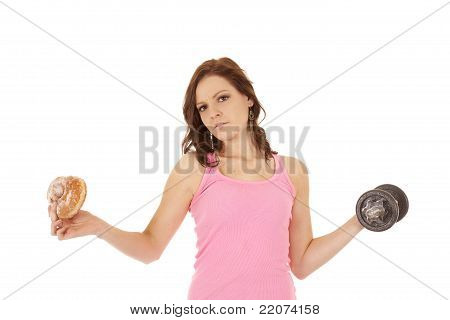 Woman With Weights And Junk Food