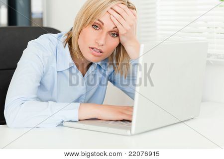 Blonde Business Woman Touching Her Forehead In Disbelieve