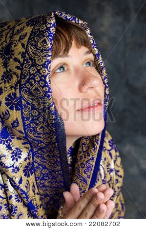 Beautiful Woman Smiling With Shawl On Head Looking Up And Praying