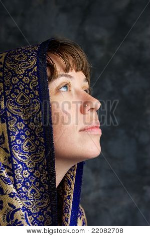 Beautiful Woman With Shawl On Head Looking Up As If Praying