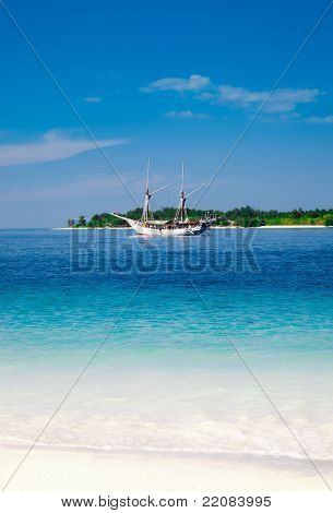 Sailing ship anchored near the tropical island. Gili, Indonesia
