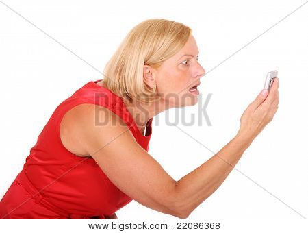 A picture of an angry woman shouting at her cell phone over white background