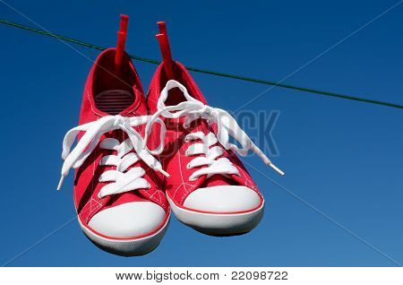 New red sneakers on washing line