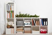 white room interior with christmas decoration, rack with items poster