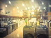Blurred Retail Store With Rows Of Washing Machines At Retail Store poster