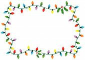 stock photo of christmas lights  - Frame made of Christmas lights and holly over white background - JPG
