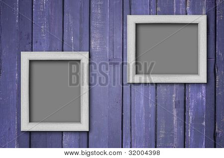 White Wood Picture Frame On Purple Wall