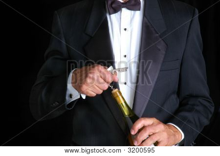 Waiter Opening Bottle Of Wine
