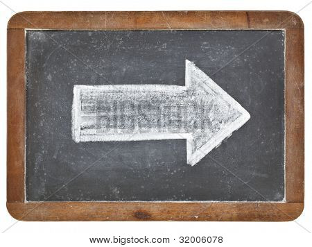 arrow - white chalk drawing on a vintage isolated slate blackboard