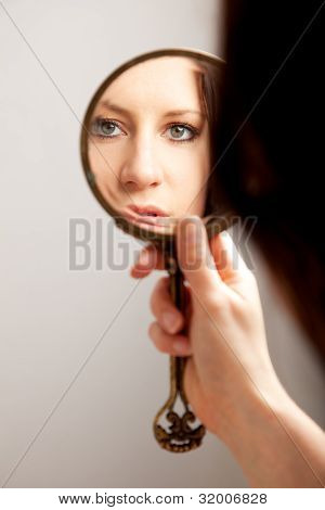 Closeup Mirror Reflection Of A Woman's Face