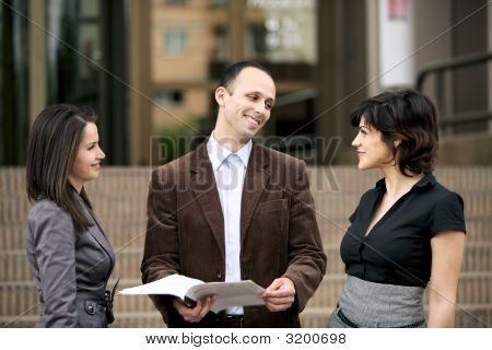 Team Of Business People Talk Outdoors