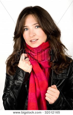 Portrait Of Young Woman Wearing Black Jacked And Red Scarf
