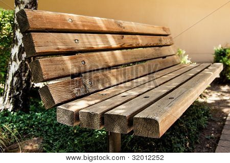 A Wooden Bench At The Park