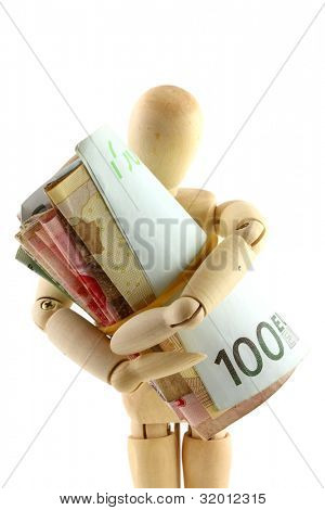 A wooden doll holding a roll of money (paper currency) tightly