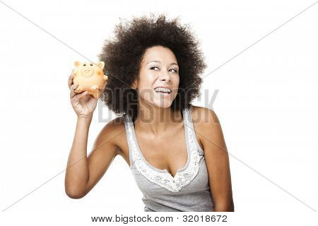Woman holding and shaking a piggy bank