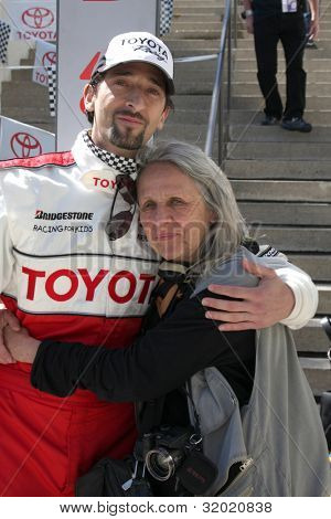 LOS ANGELES - APR 14:  Adrien Brody, mother attends the 2012 Toyota Pro/Celeb Race at Long Beach Grand Prix Course on April 14, 2010 in Long Beach, CA