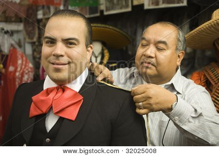 Young man being fitted for a matador outfit
