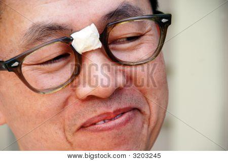 Smiling Asian Nerd In Glasses