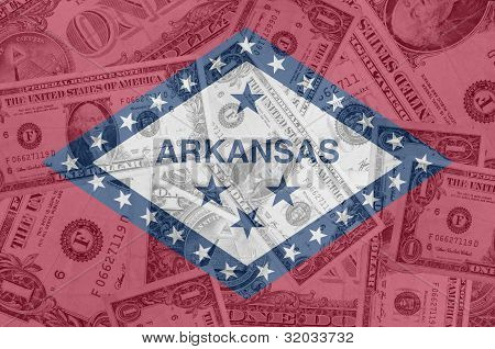 Us State Of Arkansas Flag With Transparent Dollar Banknotes In Background