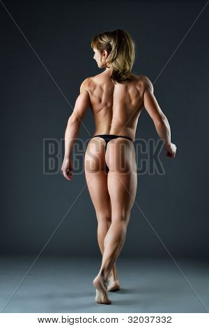 strong woman body builder show spine