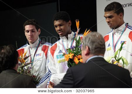 KIEV, UKRAINE - APRIL 14, 2012: French men's epee team on Medal ceremony during World Fencing Championship on April 14, 2012 in Kiev, Ukraine