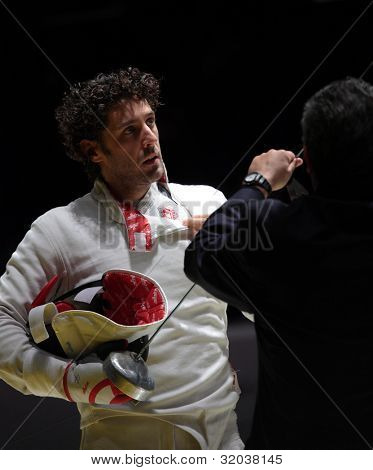 KIEV, UKRAINE - APRIL 14, 2012: Member of Hungarian team Gabor Boczko with his epee before the fight during the World Fencing Championship on April 14, 2012 in Kiev, Ukraine