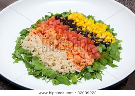 Refreshing colorful vegetable and fish salad.