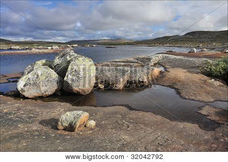 Stones in front of river, Hardangervidda, Norway