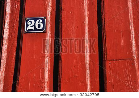 Detail of red timberhouse in Norway with number 26