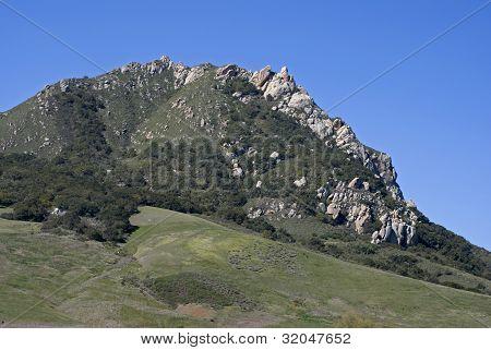 Rocky Hilltop Against Blue Sky