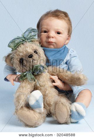 Adorable Baby With Teddy Bear