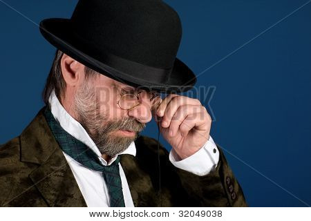 Thoughtful man in vintage pince nez