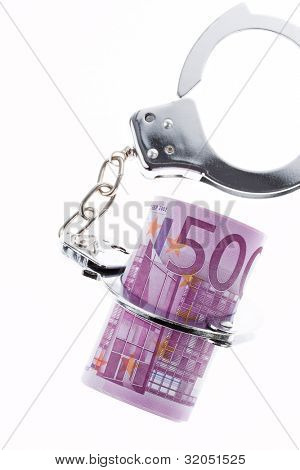 symbol of economic crime. handcuffs and �?�¢�¢�?�?�?�¬