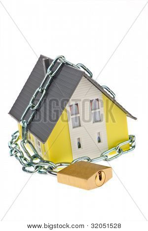 a house with chain and lock shut. alarm and security.