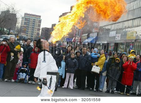 FLUSHING, NY - FEB 12: A fire breather performs at a Chinese New Year parade on February 12, 2005 in the Flushing neighborhood of New York City.