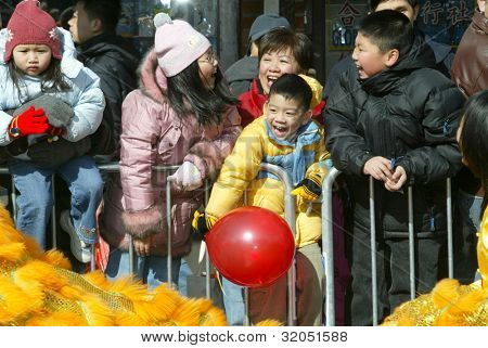 FLUSHING, NY - FEB 12: Parade goers attend a Chinese New Year Parade on February 12, 2005 in the Flushing neighborhood of New York City.