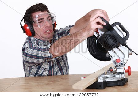 Man struggling to use a mitre saw