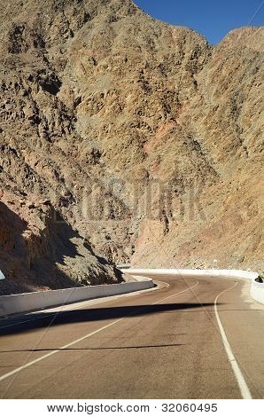 Empty Road Crossing An Arid Mountain