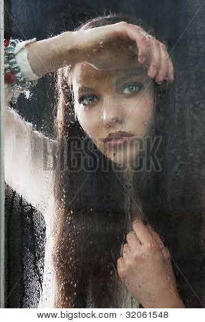 The Thinking Woman At Window Wuth Hand Near The Chest