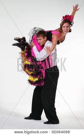 Couple Dancing Cancan In Studio