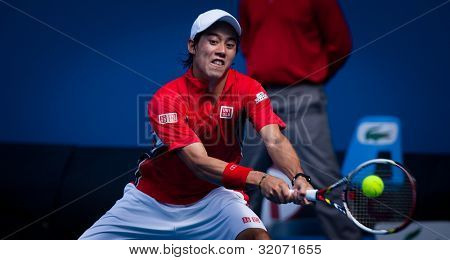 MELBOURNE - JANUARY 25: Kei Nishikori of Japan in his quarter final loss to Andy Murray of Great Britain at  the 2012 Australian Open on January 11, 2012 in Melbourne, Australia.