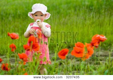 Baby-Girl With Red Flower