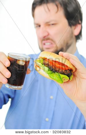 Unsatisfied man with his burger and coke