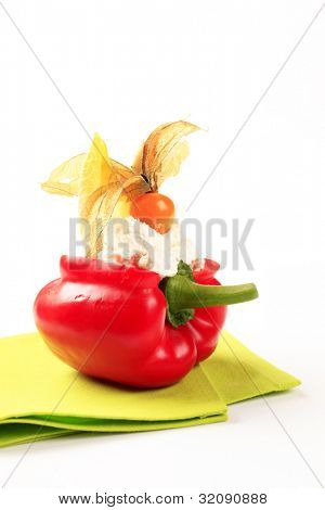 Red bell pepper with cottage cheese decorated with sallow thorn