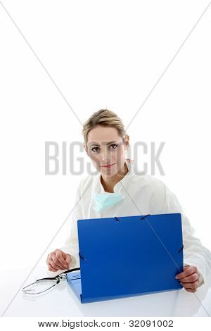 Female Doctor Consulting Patient Files