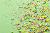Sprinkles On Light Green Background - Assorted Colourful Cake Topping Sprinkles Sprayed On Green On  poster